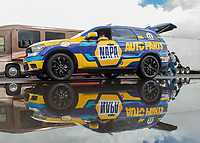 Feb 22, 2019; Chandler, AZ, USA; The tow vehicle of NHRA funny car driver Ron Capps reflects in a rain puddle in the staging lanes during qualifying for the Arizona Nationals at Wild Horse Pass Motorsports Park. Mandatory Credit: Mark J. Rebilas-USA TODAY Sports