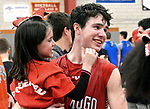 WOLCOTT, CT-031418JS02- Wamogo's Reid Turtoro (5) gets a congratulatory hug from his sister Ella Turtoro, 6, following their win over East Hampton in theDivision V semifinal game Wednesday at Wolcott High School. <br />