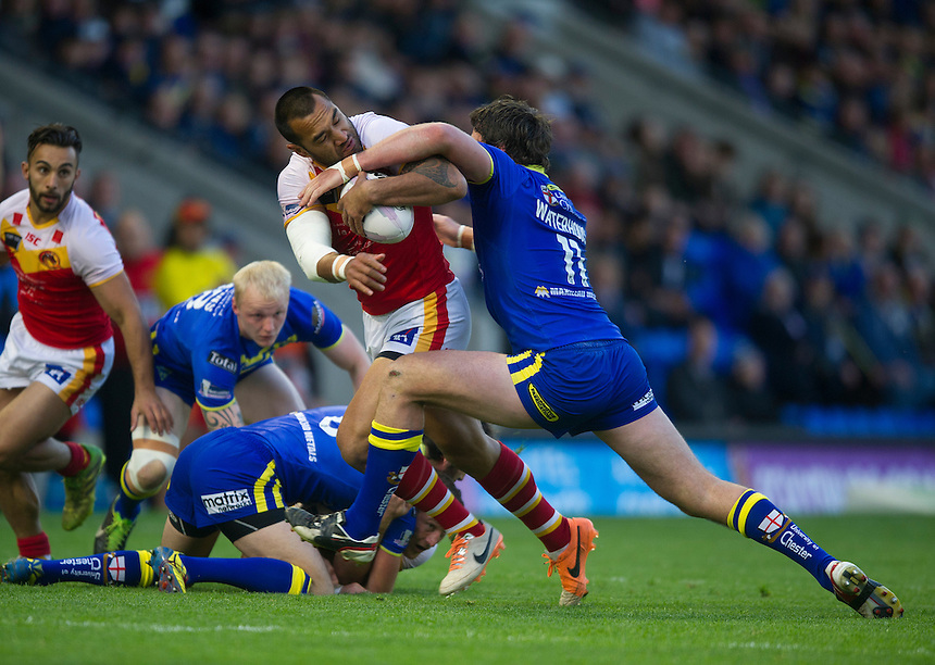 Catalan Dragons' Zeb Taia  is tackled by Warrington Wolves' Trent Waterhouse <br /> <br /> Photographer Stephen White/CameraSport<br /> <br /> Rugby League - First Utility Super League - Round 12 - Warrington Wolves v Catalan Dragons - Friday 9th May 2014 - The Halliwell Jones Stadium - Warrington<br /> <br /> &copy; CameraSport - 43 Linden Ave. Countesthorpe. Leicester. England. LE8 5PG - Tel: +44 (0) 116 277 4147 - admin@camerasport.com - www.camerasport.com