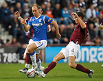 Steven Whittaker surges past the Hearts defence to set up Steven Naismith's goal