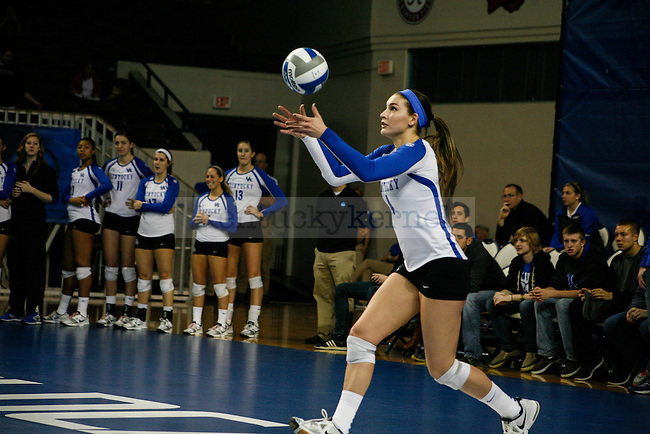 Freshman Anni Thomasson (4) serves the ball during the University of Kentucky women's volleyball game vs. Duquesne University at Memorial Coliseum  in Lexington, Ky., on Saturday, December 7, 2013. Kentucky defeated Duquesne 3-0. Photo by Adam Pennavaria | Staff