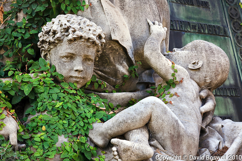 Part of a scuplture of a mother and her 2 children, at the Cementario de la Recoleta in Buenos Aires, Argentina.