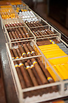Havana, Cuba; Montecristo and Cohiba cigars on the counter of Ron's Tabaco Cafe in the Fortaleza de San Carlos de la Cabana
