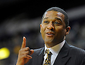UW Milwaukee Panthers head coach Rob Jeter smiles from the sidelines as his team opens a huge lead against visiting Butler at the US Cellular Arena in Milwaukee on Monday, Jan. 3, 2011. Ernie Mastroianni photo.