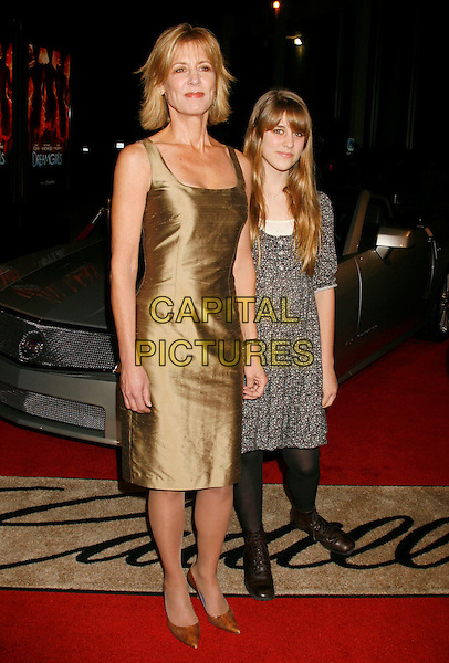 "CHRISTINE LAHTI & EMMA.""Dreamgirls"" Los Angeles Premiere held at the Wilshire Theatre, Beverly Hills, California, USA..December 11th, 2006.full length daughter mother family gold satin dress blue.CAP/ADM/RE.©Russ Elliot/AdMedia/Capital Pictures"