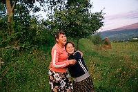 ROMANIA / Maramures / Budesti / 12.09.2006..Ileana, 16, and her friend Anna Sciop, 15 in the fields above Budesti at the end of the day...© Davin Ellicson / Anzenberger