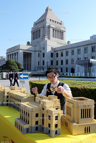 May 19, 2017, Tokyo, Japan - Japanese Lego master builder Yoshihiro Osawa puts final pieces on the Lego blocks made Diet building before the real Diet building in Tokyo on Friday, May 19, 2017 to celebrate the 70th anniversary of Japan's Upper House. The 1/70 scale model Japan's Diet building, 3m wideth and 80cm tall with some 30,000 Lego blocks will be opened for public May 20 and 21.   (Photo by Yoshio Tsunoda/AFLO) LwX -ytd-