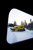 USA, Wyoming, Yellowstone National Park, a Snowcoach is ready to transport visitors for day excursions or North to Mammoth Hot Springs, the Snow Lodge at Old Faithful