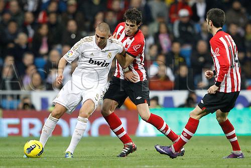 22.01.2012. Madrid Spain. La Liga  The match played between  Real Madrid and Athletic Club de Bilbao (4-1)  played at the Santiago Bernabeu Stadium.  Picture show Karim Benzema (French Forward of Real Madrid) and Markel Susaeta Laskurain (Spanish midfielder of Athletic)