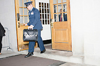 A military officer leaves the NH State House before Vice President Mike Pence leaves the New Hampshire Secretary of State's office in the New Hampshire State House in Concord, New Hampshire, on Thu., November 7, 2019. Pence traveled to New Hampshire as a surrogate for Donald Trump to file required paperwork for the president to get on the New Hampshire presidential primary ballot in 2020. The required documents include a filing form signed by the candidate and a $1000 filing fee.