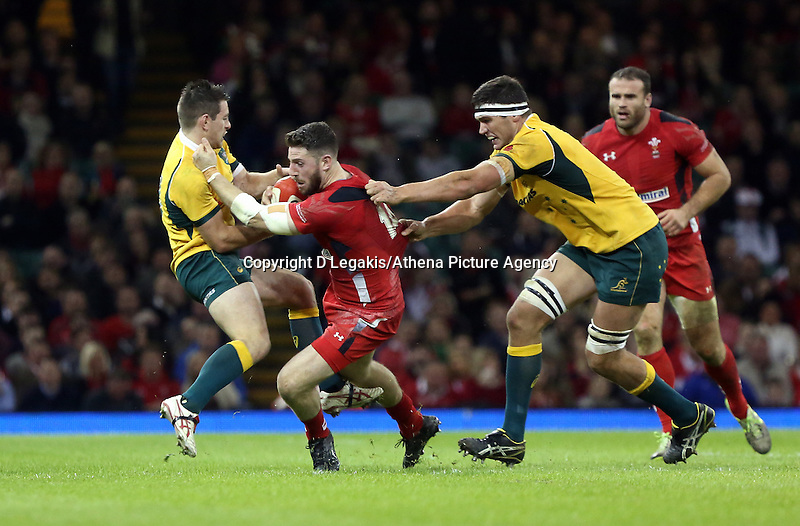Pictured: Alex Cuthbert of Wales (C) is brought down by two Australia players Saturday 08 November 2014<br /> Re: Dove Men Series rugby, Wales v Australia at the Millennium Stadium, Cardiff, south Wales, UK.