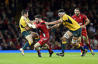 Pictured: Alex Cuthbert of Wales (C) is brought down by two Australia players Saturday 08 November 2014<br />