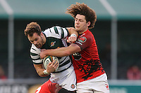 Joe Munro of Ealing Trailfinders (centre) is tackled by Sebastian Jewell of London Welsh (3rd left) and Benjamin Pienaar of London Welsh (right) during the Greene King IPA Championship match between Ealing Trailfinders and London Welsh RFC at Castle Bar , West Ealing , England  on 26 November 2016. Photo by David Horn / PRiME Media Images