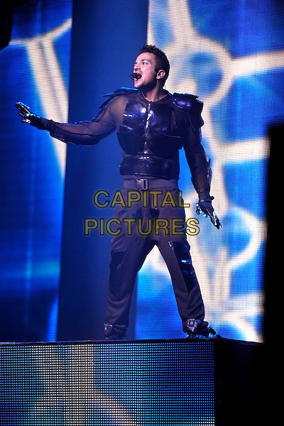 Peter Andre performs at Oxford New Theatre as part of his 'Up Close and Personal' tour, Oxford, England..November 20th 2012.on stage in concert live gig performance performing music full length black trousers top gloves hand arm profile armour armor .CAP/JIL.©Jill Mayhew/Capital Pictures