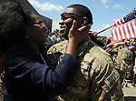 Specialist Anthony Bennett,  gets a tearful welcome fromhis mom Geanetta,  both of Windsor, Thursday, August 15, 2013, at the Air National Guard base in East Granby.  About 160 Connecticut National Guard soldiers of the 1048th Transportation Company of Stratford were welcomed home from Afghanistan after an 11 month deployment.  (Jim Michaud / Journal Inquirer)
