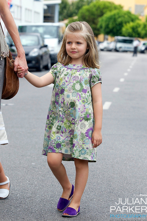 Crown Princess Letizia, and daughters Princess Leonor, and Princess Sofia, arrive at The Royal Yacht Club, in Palma, Mallorca, to meet.Crown Prince Felipe after he  competed  in the second day of the Copa Del Rey sailing regatta..( Princess Leonor in picture )