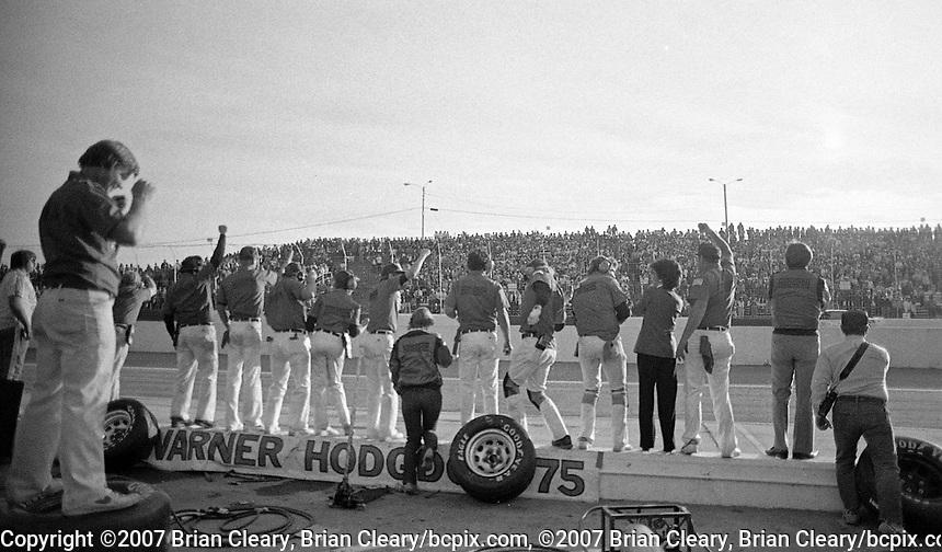 Atlanta Journal 500 at Atlanta International Raceway in Hampton, GA on November 6, 1983. (Photo by Brian Cleary/www.bcpix.com)  Atlanta Journal 500, Atlanta Motor Speedway, Hampton, Georgia, November 6, 1983.  (Photo by Brian Cleary/www.bcpix.com)  Neil Bonnett's pit crew celebrates as he crosses the finish line to win the Atlanta Journal 500 at Atlanta International Raceway in Hampton, GA on November 6, 1983. (Photo by Brian Cleary/www.bcpix.com)