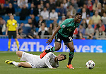 Real Madrid's forward Isco vies with Schalke's Obasi during the UEFA Champions League football match Real Madrid CF vs Schalke 04 FC at the Santiago Bernabeu stadium in Madrid on March 18, 2014.  PHOTOCALL3000/ DP