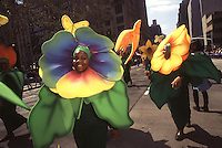 (950422-SWR04.jpg) - 22 April 1995 - New York, NY -- Earth Day New York City. Parade of the Planets. Environmentalists dressed as colorful flowers march up the Avenue of the Americas.