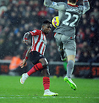 Eljero Elia of Southampton is challenged by Liverpool goalkeeper Simon Mignolet - Barclays Premier League - Southampton vs Liverpool - St Mary's Stadium - Southampton - England - 22nd February 2015 - Pic Robin Parker/Sportimage