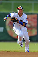 Tennessee Smokies shortstop Javier Baez #9 fields the ball during game one of a double header against the Huntsville Stars at Smokies Park on July 8, 2013 in Kodak, Tennessee. The Stars won the game 2-0. (Tony Farlow/Four Seam Images)
