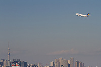 A Boeing 747-830 (Jumbo Jet) operated by German carrier, Lufthansa takes off over Tokyo Skytree from Haneda International Airport, Tokyo, Japan. Friday February 1st 2019