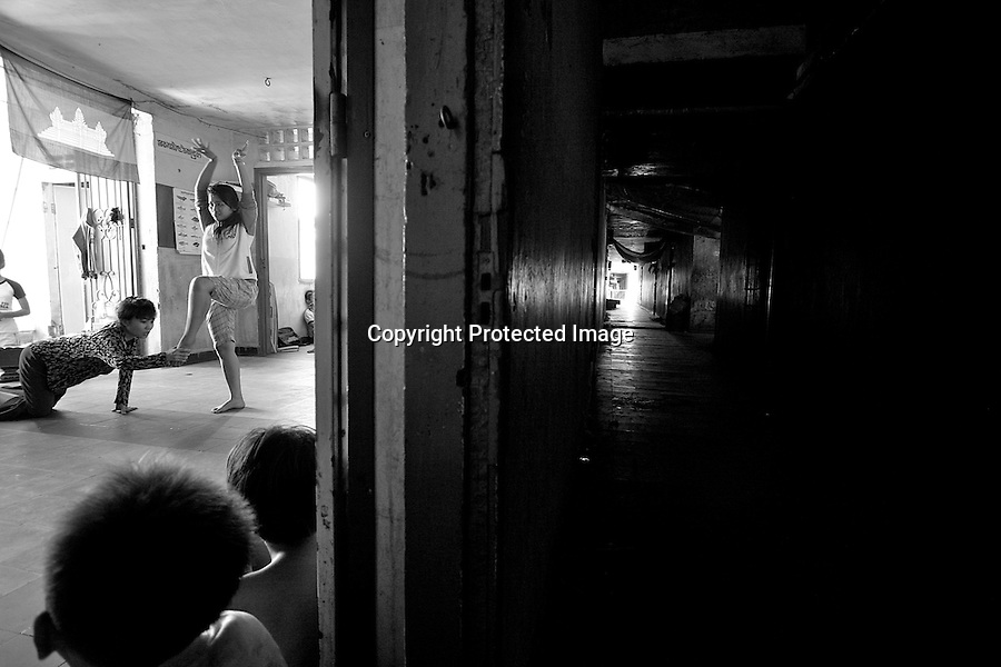 "On the third floor of a run down building, called ""white building"", in the Bassac area, Phnom Penh, Cambodia, children learn traditional and classical dances, music, singing and theatre. Lead by Master Ieng Sithul, this class includes 25 students ranging from ages 10-25. The aim is to offer an alternative to the children facing daily hardships, to offer hope for the future and opportunities for an artistic way of life"