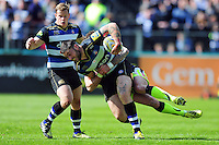 Matt Banahan of Bath Rugby is tackled in possession. Aviva Premiership match, between Bath Rugby and Sale Sharks on April 23, 2016 at the Recreation Ground in Bath, England. Photo by: Patrick Khachfe / Onside Images