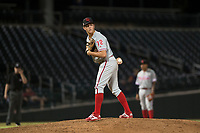 Scottsdale Scorpions relief pitcher Seth McGarry (72), of the Philadelphia Phillies organization, checks the runner at first base during an Arizona Fall League game against the Mesa Solar Sox at Sloan Park on October 10, 2018 in Mesa, Arizona. Scottsdale defeated Mesa 10-3. (Zachary Lucy/Four Seam Images)