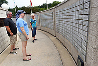 NWA Democrat-Gazette/FLIP PUTTHOFF <br /> HONORING VETERANS<br /> Steven Morris (from left), Kendra Moke and Loretta Lesley, visiting from out of the area, tour Tuesday Aug. 13 2019 the Veterans Wall of Honor in Bella Vista. The memorial honors veterans from Northwest Arkansas an around the nation who have served in all branches of the military. The memorial, at 103 Veterans Way in Bells Vista, is inscribed with the names of some 5,000 veterans who have served in many conflicts. A timeline of major military events is part of the memorial.