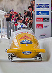 9 January 2016: Swiss pilot Rico Peter leads his 4-man team as they cross the finish line after their second run of the day at the BMW IBSF World Cup Bobsled Championships at the Olympic Sports Track in Lake Placid, New York, USA. Peter's team came in 5th for the day, with a 2-run combined time of 1:50.13. Mandatory Credit: Ed Wolfstein Photo *** RAW (NEF) Image File Available ***