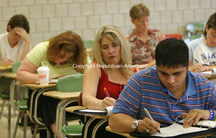 WATERBURY, CT 19 July 2005 -071905BZ12- Students, including Ruth Ruesch, of Woodbury, (second from right) take notes and listen to the instructor during a legal assistant/paralegal class at Naugatuck Valley Community College in Waterbury Monday. <br /> Jamison C. Bazinet Photo