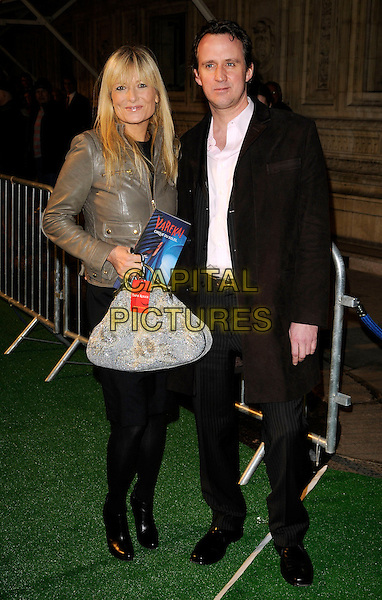 """GABY ROSLIN & GUEST.Attending the Cirque Du Soleil """"Varekai"""" Premiere at the Royal Albert Hall, London, England, January 8th 2007..full length grey leather biker jacket bag.CAP/CAN.©Can Nguyen/Capital Pictures"""