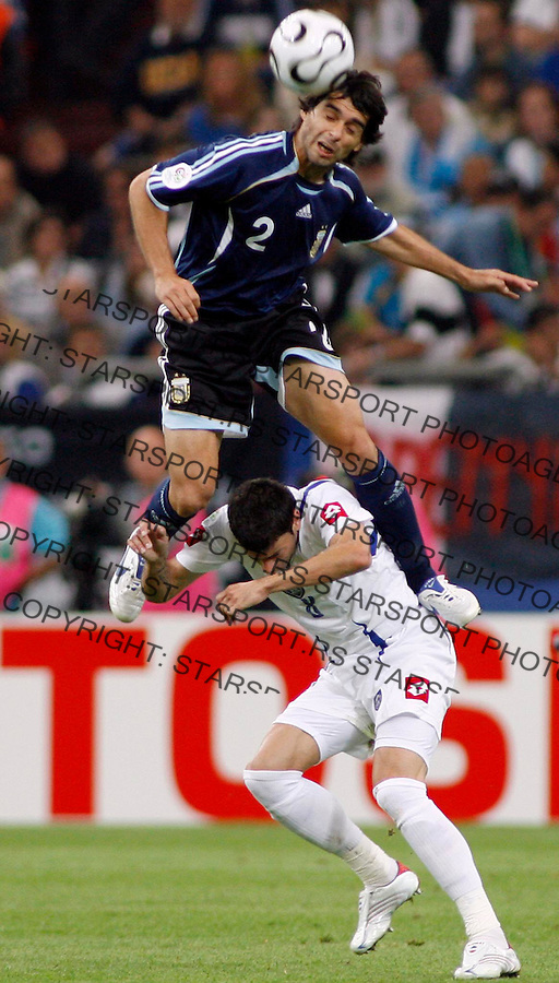 Jun 16, 2006; GELSENKICHEN, Germany; Argentinadefender AYALA Roberto(@) jump over  Serbia forward KEZMAN Mateja (8) during the first half of the opening round FIFA World Cup soccer match between Argentina &amp; Serbia and Montenegro, at the World Cupa Arena at GELSENKICHEN, Germany. Mandatory &copy; 2006 Srdjan Stevanovic&amp;#xA;<br />