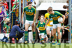 Fionn Fitzgerald with Clodagh O'Shea, Killorglin Kerry team takes to the field before the Munster Senior Football Final at Fitzgerald Stadium on Sunday.