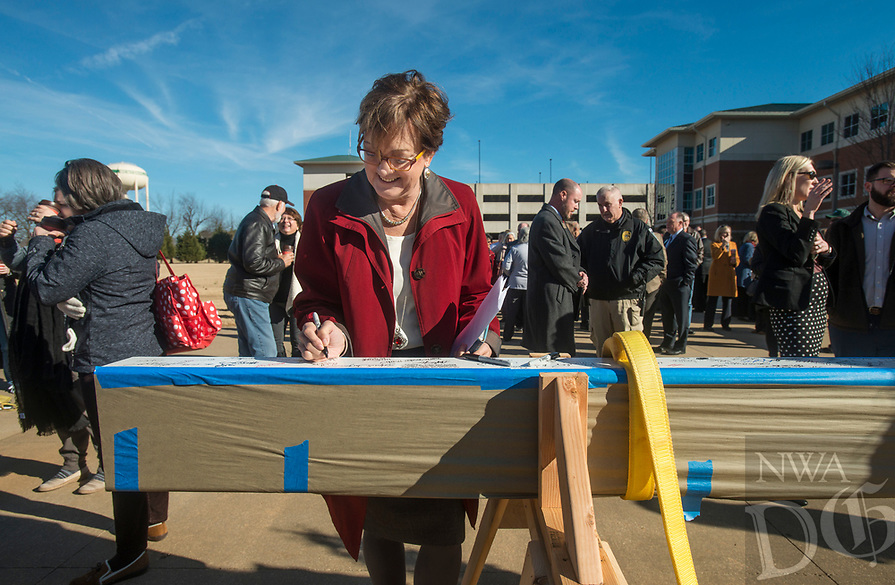 NWA Democrat-Gazette/BEN GOFF @NWABENGOFF<br /> Evelyn Jorgenson, Northwest Arkansas Community College president, signs the ceremonial final beam Wednesday, Jan. 9, 2019, during a topping-out ceremony for the new Integrated Design Lab at Northwest Arkansas Community College in Bentonville. Construction began on the new facility in July. It will be home to the college's workforce construction management and visual arts programs when completed.