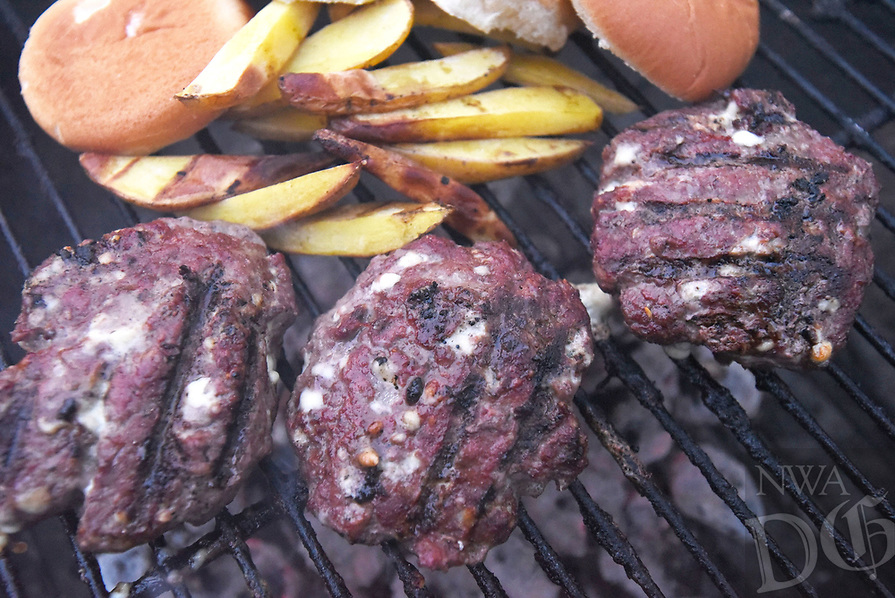 NWA Democrat-Gazette/FLIP PUTTHOFF<br />An official Camp See No Deer Blue Cheeseburger is made with      Feb. 16 2018       ground venision, but ground beef, turkey or any ground meat is an acceptable substitute. Grill some potatoes cut steak-fry style while the burgers are cooking for a true feast.