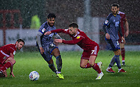 Lincoln City's Liam Bridcutt vies for possession with Accrington Stanley's Jordan Clark<br /> <br /> Photographer Andrew Vaughan/CameraSport<br /> <br /> The EFL Sky Bet League One - Accrington Stanley v Lincoln City - Saturday 15th February 2020 - Crown Ground - Accrington<br /> <br /> World Copyright © 2020 CameraSport. All rights reserved. 43 Linden Ave. Countesthorpe. Leicester. England. LE8 5PG - Tel: +44 (0) 116 277 4147 - admin@camerasport.com - www.camerasport.com