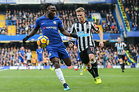 Victor Moses of Chelsea under pressure from Matt Ritchie of Newcastle United during the Premier League match between Chelsea and Newcastle United at Stamford Bridge, London, England on 2 December 2017. Photo by David Horn.