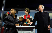 WASHINGTON - DECEMBER 7:  US President George W Bush (R) and First Lady Laura Bush (C) are helped by Attiya Jenkins (L), Stephen Scott (2L) and Dana Bederson (2R) to light the national Christmas Tree on the Ellipse December 7, 2006 in Washington, DC.  The tree lighting was part of the 2006 Christmas Pageant of Peace.  (Pool Photo by Brendan Smialowski/Getty Images)