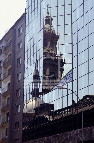 Santiago, Chile. Old church reflected in a modern mirrored building.