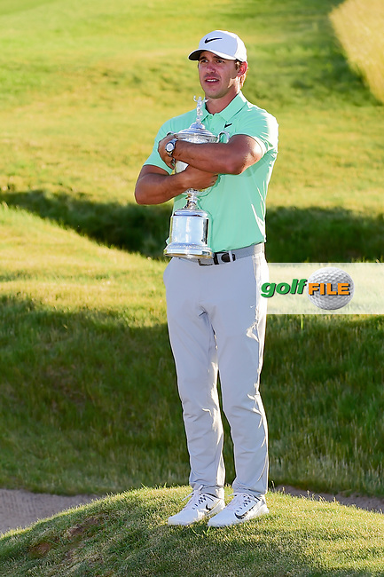 Brooks Koepka (USA) hugs the trophy for winning the 117th U.S. Open, at Erin Hills, Erin, Wisconsin. 6/18/2017.<br /> Picture: Golffile   Ken Murray<br /> <br /> <br /> All photo usage must carry mandatory copyright credit (&copy; Golffile   Ken Murray)