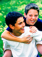 Two young pre teens playing outdoors