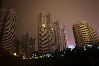 CHINA. Sichuan Province. Chongqing. Housing developments near The Yangtze River which is at its lowest level in 150 years as a result of a country-wide drought. Chongqing is a city of over 3,000,000 people, famed for being the capital of China between 1938 and 1946 during World War II. It is situated on the banks of the Yangtze river, China's longest river and the third longest in the world. Originating in Tibet, the river flows for 3,964 miles (6,380km) through central China into the East China Sea at Shanghai.  2008.