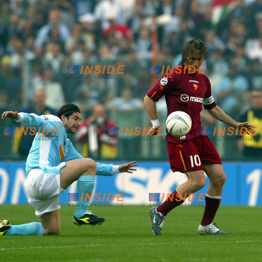 Roma 21/4/2004 Campionato Italiano Serie A <br /> Lazio - Roma 1-1 <br /> Giuliano Giannichedda (Lazio) and Francesco Totti  (Roma)<br /> Lazio and Roma are playing again after it was suspended on March 21, 2004, for security reasons.  <br /> Foto Andrea Staccioli Insidefoto