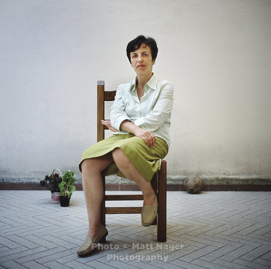Bruna Gambardella (cq), sits in the patio at her home in Marigliano, Italy, June 9, 2010. Gambardella, has experienced endometriosis and a weakened immune system due to high levels of PCBs accumulated in ground water and produce found in Marigliano. In 2008, Antonino Vassallo, a member of the Camorra, confessed to dumping toxic waste into the countryside around the provinces of Naples and Caserta. Gambardella has turned to organic farms to avoid eating local produce and has noticed some relief of health symptoms and a rise in energy. ..PHOTO/ MATT NAGER