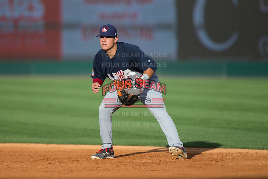 US Collegiate National Team first baseman KJ Harrison (34) on defense against the Cuban National Team at BB&T BallPark on July 4, 2015 in Charlotte, North Carolina.  The United State Collegiate National Team defeated the Cuban National Team 11-1.  (Brian Westerholt/Four Seam Images)