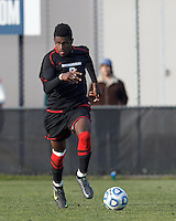Northeastern University forward Terence Carter (8) looks to pass..NCAA Tournament. University of Connecticut (white) defeated Northeastern University (black), 1-0, at Morrone Stadium at University of Connecticut on November 18, 2012.