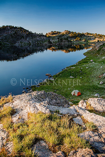 Early morning light on the hills around north hidden lake and a backpacking tent camp in the beartooth wilderness in montana