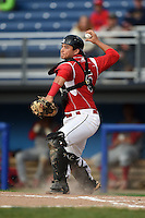 Batavia Muckdogs catcher Christopher Hoo (5) throws to third during the second game of a doubleheader against the Williamsport Crosscutters on July 29, 2014 at Dwyer Stadium in Batavia, New York.  Batavia defeated Williamsport 1-0.  (Mike Janes/Four Seam Images)